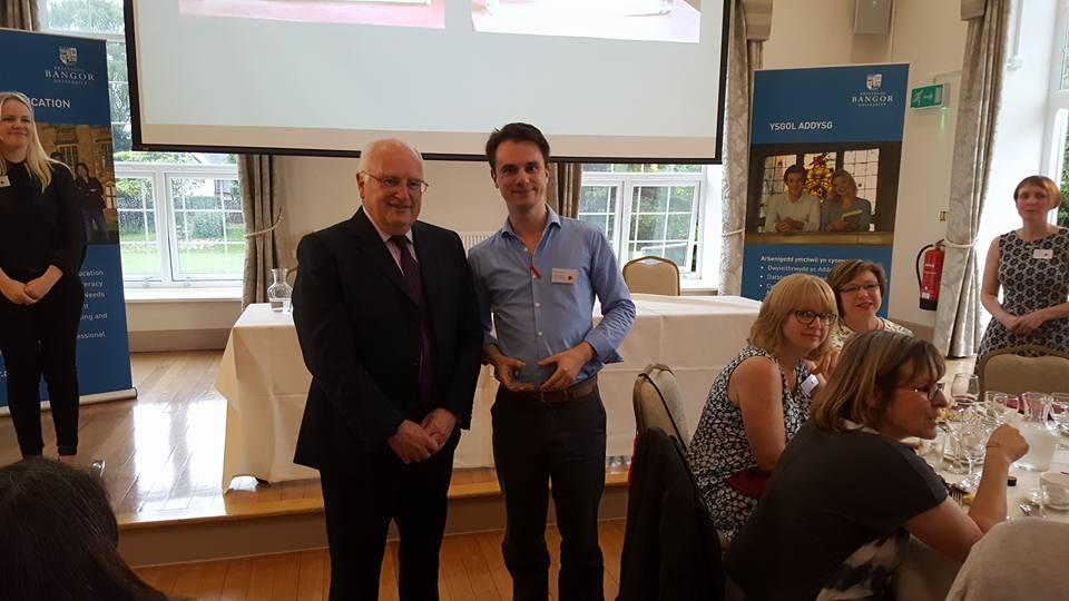 Congratulations to Thomas Somers for winning the student presentation competition. Here he is accepting his prize from Professor Colin Baker.
